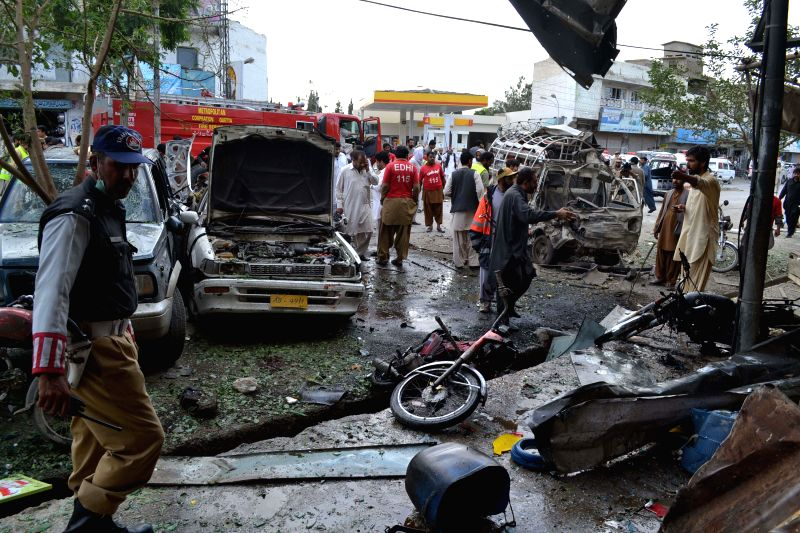 Photo: Security officials inspect the blast site in Quetta, southwest of Pakistan, on May 8, 2014. At least two people were killed and 16 others injured when a bomb ...