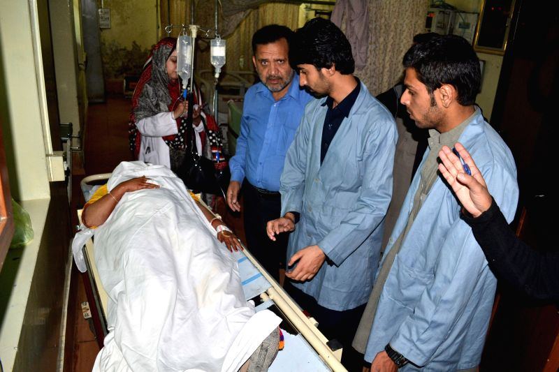 Quetta (Pakistan): An injured female polio health worker receives medical treatment at a hospital in southwestern Pakistan's Quetta on Nov. 26, 2014. At least four polio workers were killed and three