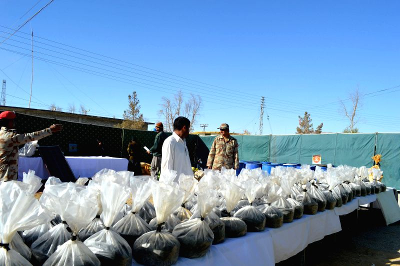 Pakistani paramilitary Frontier Corps officers display explosive materials seized during an operation in southwest Pakistan's Quetta, Dec. 4, 2014. Frontier Corps recovered huge quantities of
