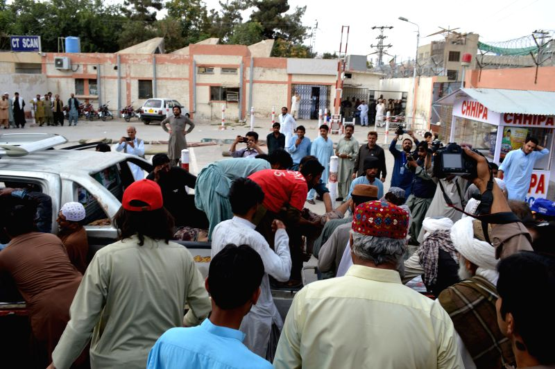 QUETTA,People transfer an injured man to hospital in southwest Pakistan's Quetta on July 13, 2018. At least 30 people were killed and 60 others injured after a ...