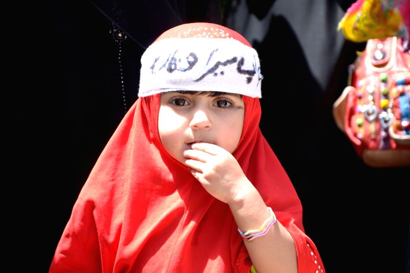 A Pakistani girl wears hijab during a rally to mark World Hijab Day in southwest Pakistan's Quetta, Sept. 4, 2014. Nationwide rallies were organized to highlight the