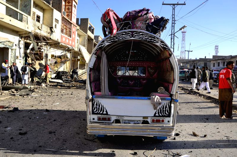 QuettaPhoto taken on Dec. 4, 2014 shows a damaged vehicle at the blast site in southwest Pakistan's Quetta. At least one man was killed and nine others wounded when a bomb exploded near a vegetable ..