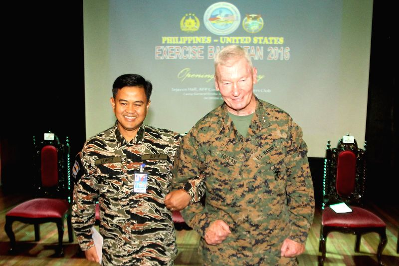 QUEZON CITY, April 4, 2016 - U.S. Exercise Director Lt. Gen. John Toolan of the U.S. Marine Corps (R) links arms with PH Exercise Director Vice Admiral Alexander S. Lopez of the Armed Forces of the ...