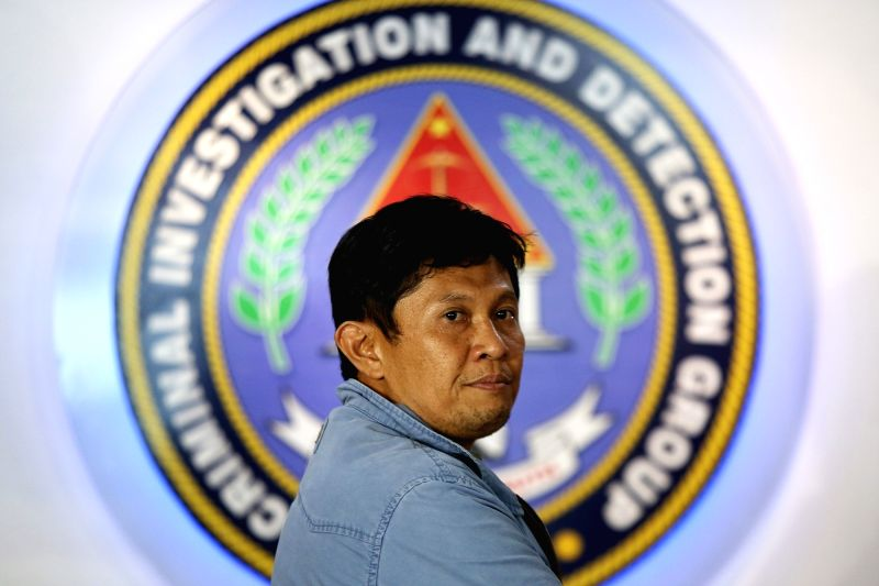 QUEZON CITY, Aug. 8, 2016 - Talitay Mayor Montasir Sabal arrives at the Criminal Investigation and Detection Group to present himself at the Philippine National Police headquarters in Quezon City, ...