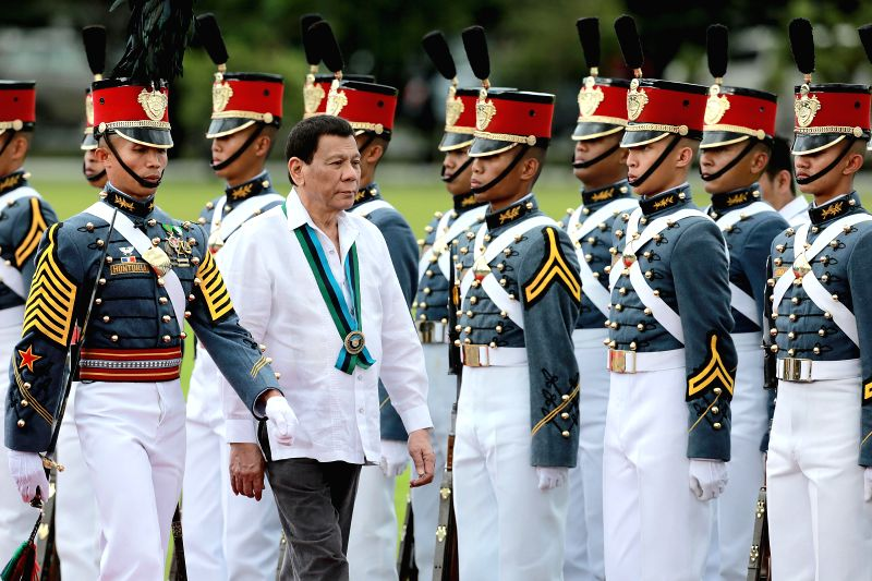 Duterte threatens communist rebels who 'molest women&#39