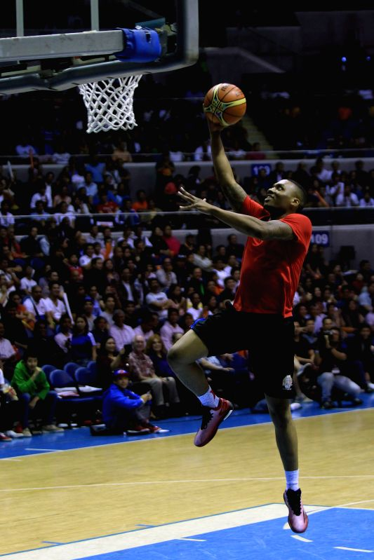 Damian Lillard of Portland Trail Blazers goes to the basket during a charity event in Quezon City, the Philippines, July 22, 2014. Nine NBA players participated