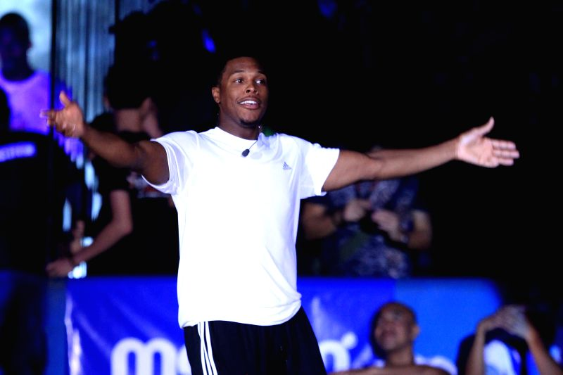 Kyle Lowry of Toronto Raptors participates in a charity event in Quezon City, the Philippines, July 22, 2014. Nine NBA players participated in the charity event