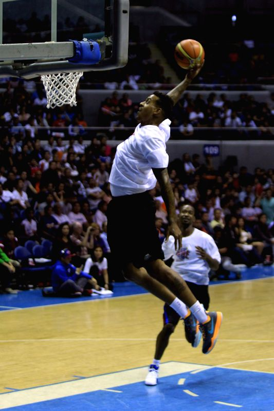 Matt Barnes (Top) of Los Angeles Clippers goes to the basket during a charity event in Quezon City, the Philippines, July 22, 2014. Nine NBA players ...