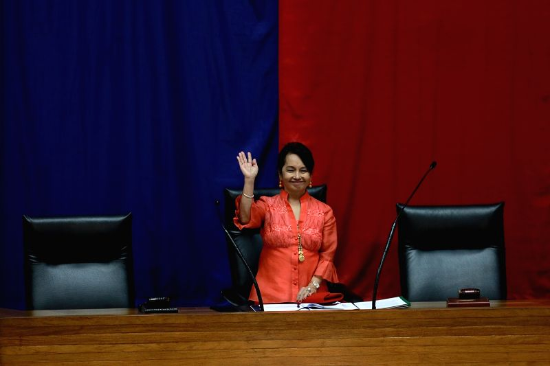 QUEZON CITY, July 23, 2018 - Former Philippine President and current Representative Gloria Arroyo waves to her colleagues after being elected as new Speaker of the House of Representatives in Quezon ... - Pantaleon Alvarez