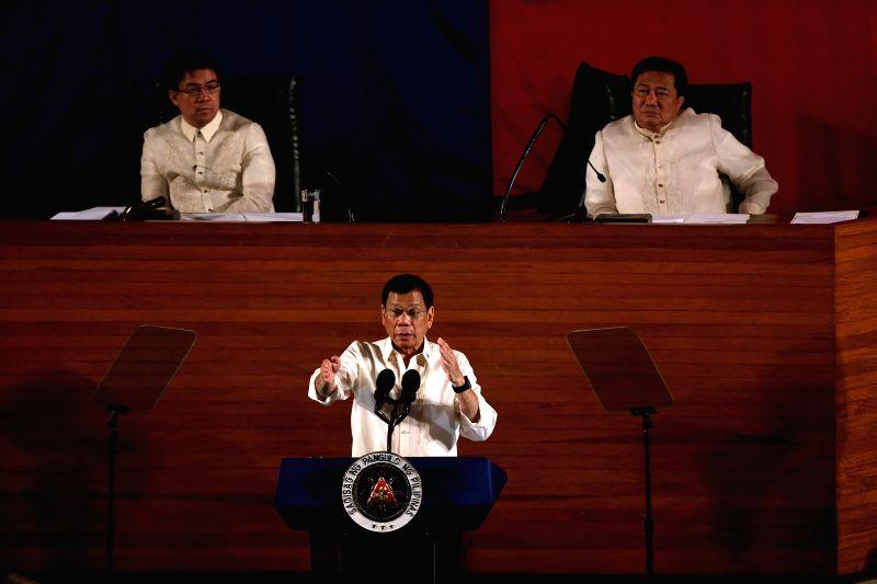 QUEZON CITY, July 25, 2016 - Philippine President Rodrigo Duterte (C) speaks during the State of the Nation Address in Quezon City, the Philippines, July 25, 2016. Philippine President Rodrigo ...