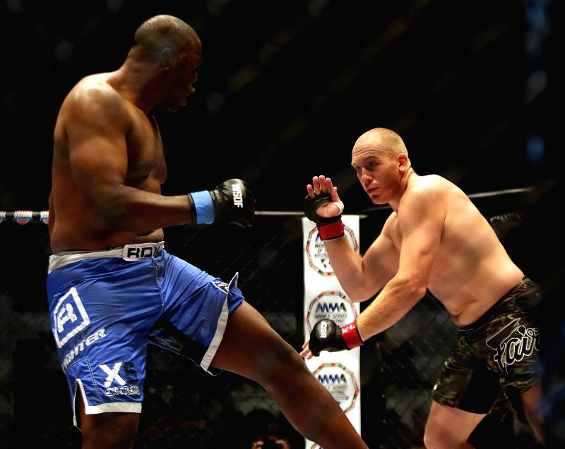 QUEZON CITY, July 31, 2016 - Evgeny Erokhin of Russia (R) competes against Richard Odoms of the United States during their heavyweight championship match in the World Series of Fighting Global ...