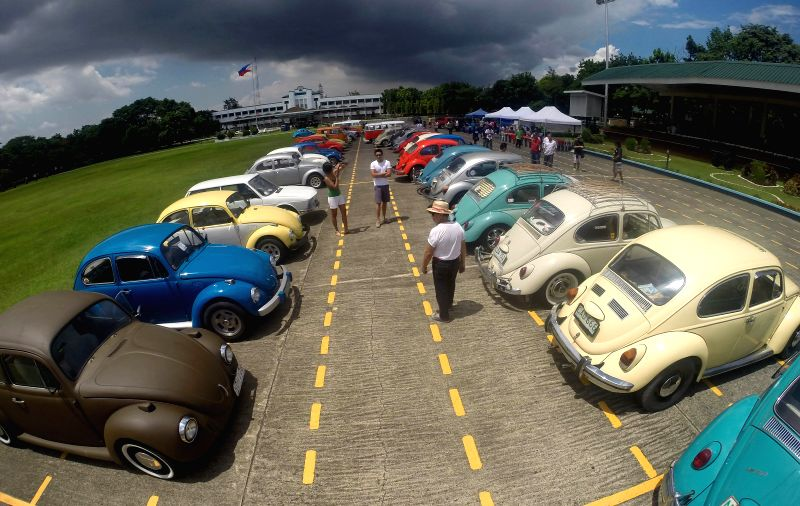 People look at Volkswagen cars in an exhibition at Camp Aguinaldo in Quezon City, Philippines on June 22, 2014. Hundreds of Volkswagen owners and enthusiasts ...