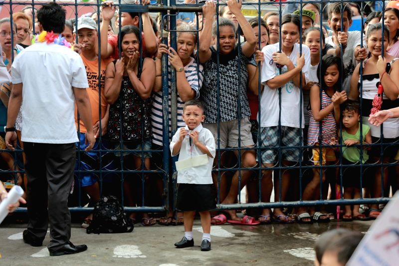QUEZON CITY, June 5, 2017 - A student cries as parents crowd the gate during the first day of school inside President Corazon C. Aquino Elementary School in Quezon City, the Philippines, June 5, 2017.