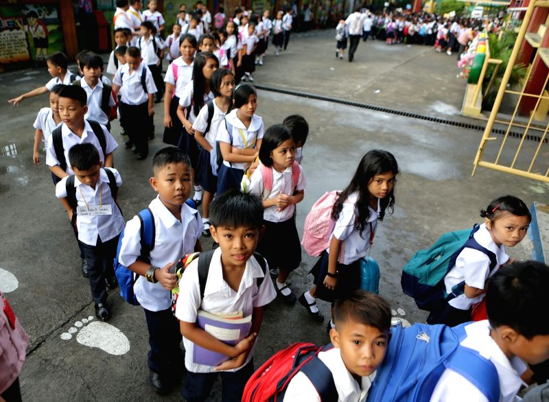 QUEZON CITY, June 5, 2017 - Students line up as they walk to their classrooms during the first day of school inside President Corazon C. Aquino Elementary School in Quezon City, the Philippines, June ...