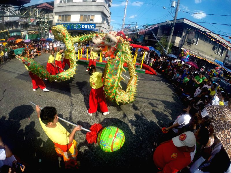 Dragon dancers perform during the annual Lechon Festival in Quezon City, the Philippines, May 18, 2014. The Lechon Festival is celebrated by parading roasted ...