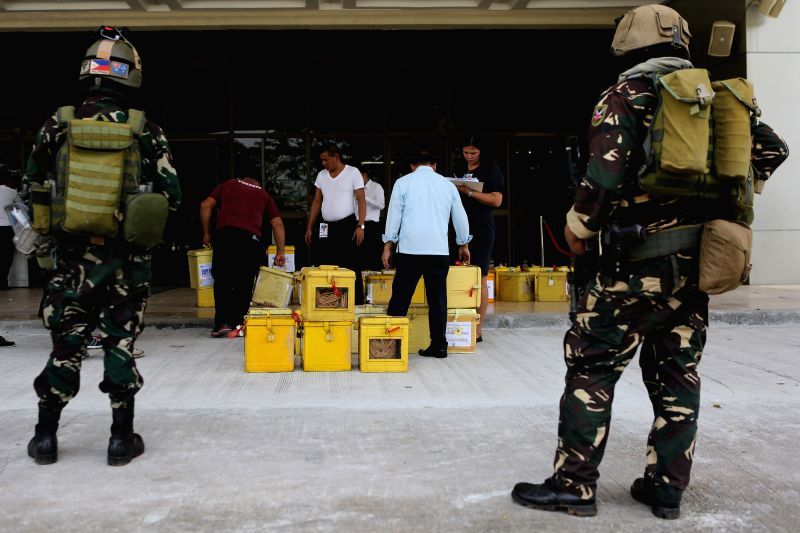 QUEZON CITY, May 24, 2016 - Soldiers from the Armed Forces of the Philippines (AFP) stand guard as ballot boxes containing certificates of canvass are checked at the House of Representatives in ...