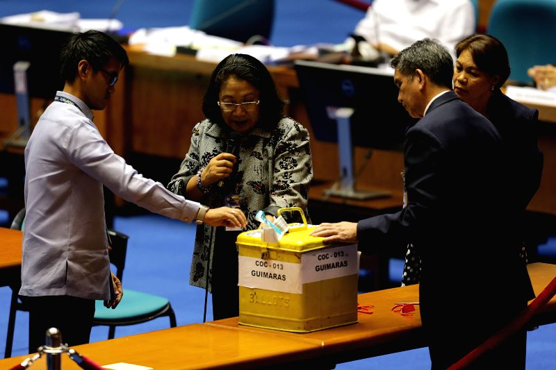QUEZON CITY, May 25, 2016 - Senates, Congress officials and election lawyers check a ballot box during the official counting of votes from the May 9 elections of president and vice president at the ...