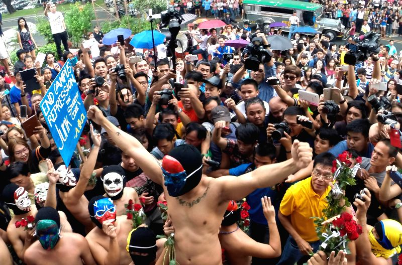 "Quezon City: The crowd cheers as naked members of the Alpha Phi Omega fraternity hold the 37th annual ""oblation run"" at the University of the Philippines in Quezon City, the Philippines, ..."