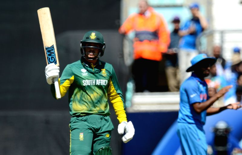 Quinton de Kock of South Africa celebrates his half century during an ICC Champions Trophy match between India and South Africa at Kennington Oval in London on June 11, 2017.