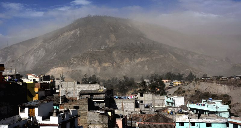 A dust cloud rises after a landslide caused by an earthquake in Quito, capital of Ecuador, on Aug. 12, 2014. A 5.1 magnitude earthquake rocked outside Ecuador's ...