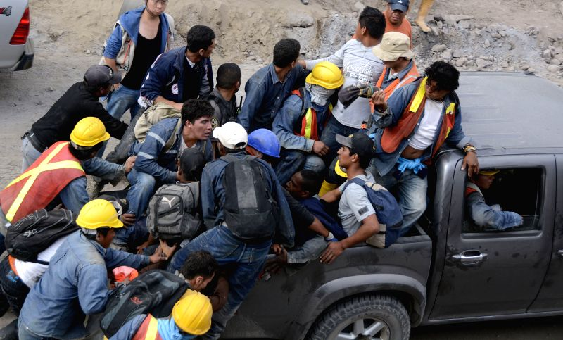 Workers are evacuated from a mine after an earthquake in Quito, capital of Ecuador, on Aug. 12, 2014. A 5.1 magnitude earthquake rocked outside Ecuador's capital ..