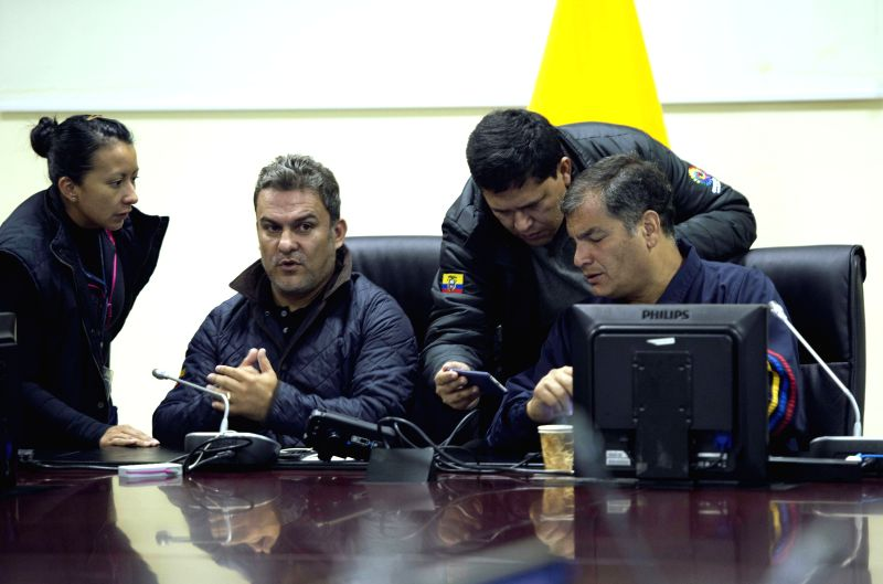 QUITO, May 18, 2016 - Ecuadorian President Rafael Correa (1st R) meets with members of the Committee of Emergency Operations (COE) after an earthquake at the Integrated Security Service ECU 911 in ...