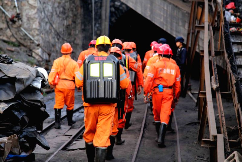 Rescuers work at the site of gas blast in a pit of Hongtutian Coal Mine in Fuyuan County of Qujing City, southwest China's Yunnan Province, April 21, 2014. The ...