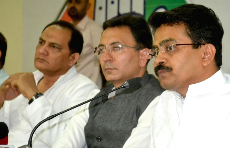 (R to L) Congress leaders Rajiv Satav, Jitin Prasada and Mohammad Azharuddin during a press conference regarding Karnataka Assembly Polls in Bengaluru on April 26, 2018. - Azharuddin