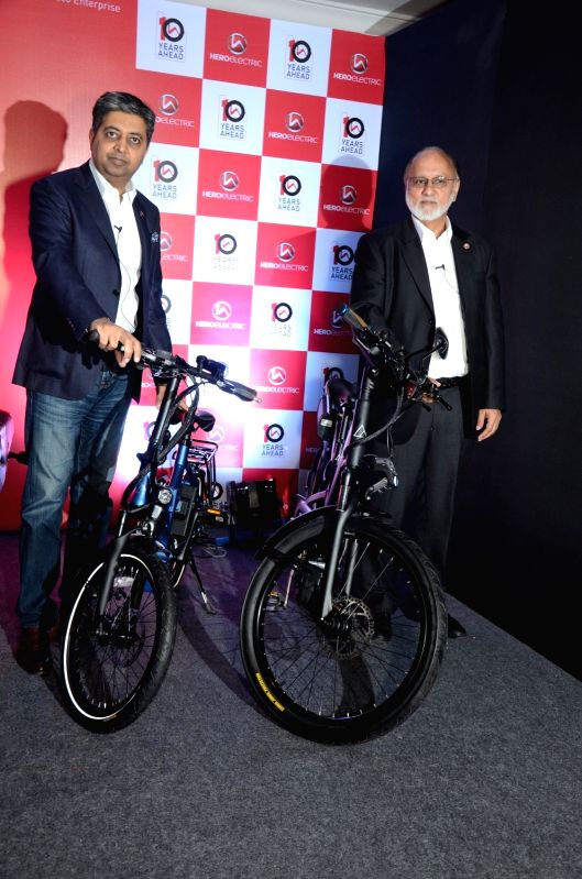 (R to L) Hero Electric CEO Sohinder Gill and Managing Director Naveen Munjal unveils electric bicycles A2B Speed and Kuo Boost in New Delhi on Feb 2, 2018.