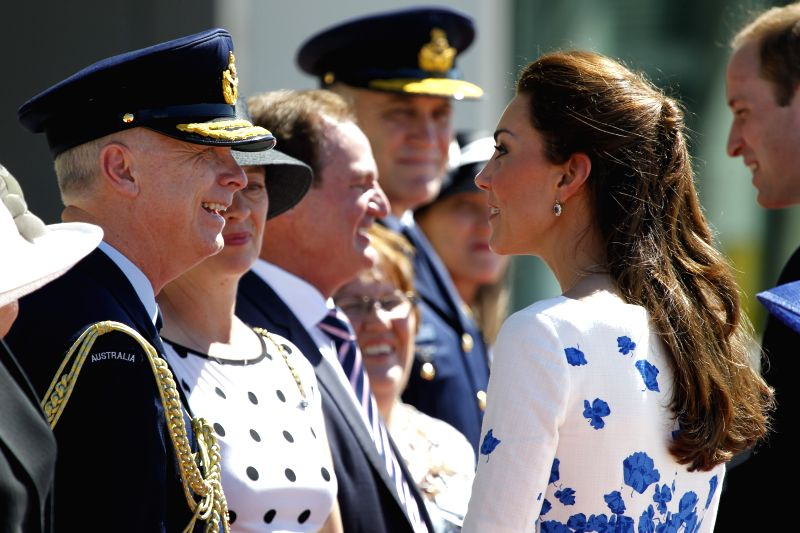 British Prince William and his wife Kate, Duchess of Cambridge, meet with Vice Chief of the Defence Force Air Marshal Mark Binskin at the RAAF Base ...