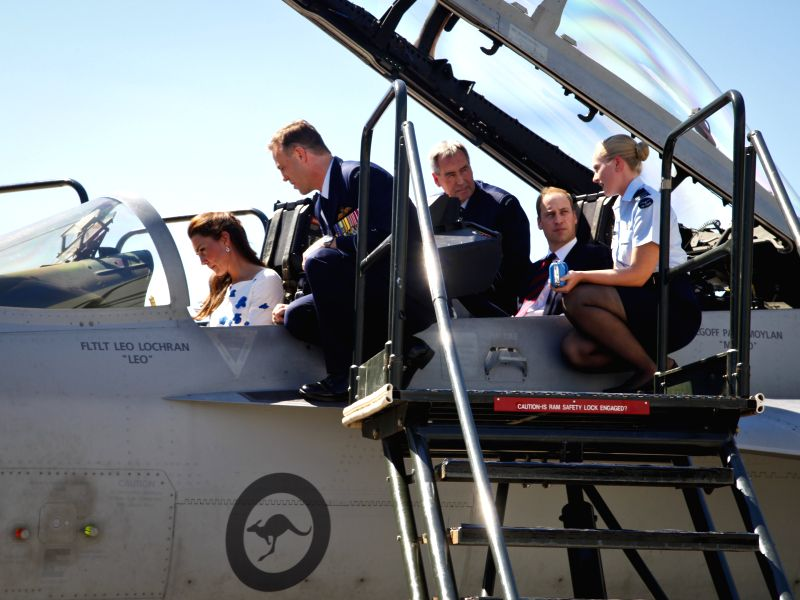 British Prince William and his wife Kate, Duchess of Cambridge, are shown the cockpit of an F/A-18 Super Hornet at the RAAF Base Amberley, near ...