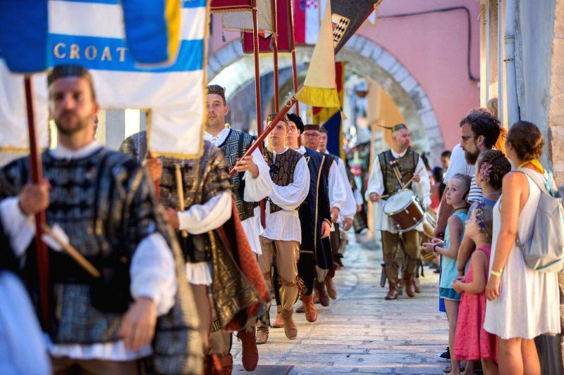 RAB ISLAND (CROATIA), July 28, 2018 Performers in ancient costume attend Rabska fjera on the island of Rab in Croatia, on July 27, 2018. Rabska fjera is a medieval summer fair based on ...