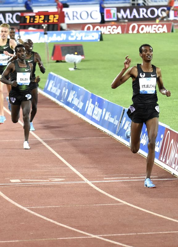 RABAT, July 14, 2018 - Ethiopia's Yomif Kejelcha (1st R) crosses the finish line during the men's 3000m at the IAAF Diamond League meeting in Rabat, Morocco, July 13, 2018. Yomif Kejelcha claimed the ...