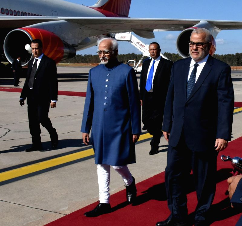 Rabat (Morocco): Vice President M. Hamid Ansari with the Prime Minister of Morocco, Abdelilah Benkirane on his arrival, at Sale International Airport, in Rabat, Morocco on May 30, 2016.