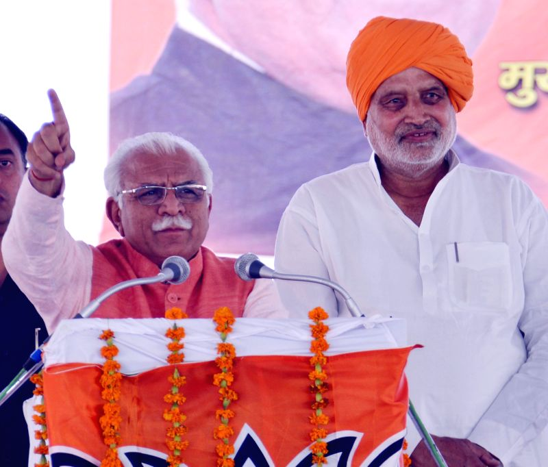 Haryana Chief Minister Manohar Lal Khattar addresses during a public meeting in Radaur of Haryana on April 10, 2015. - Manohar Lal Khattar