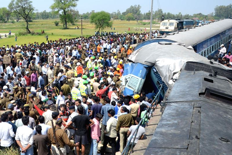 Rescue operations underway at the site where two coaches of Dehradun-Varanasi Janta Express derailed in Raebareli of Uttar Pradesh on March 20, 2015. At least 15 people were killed in the ...