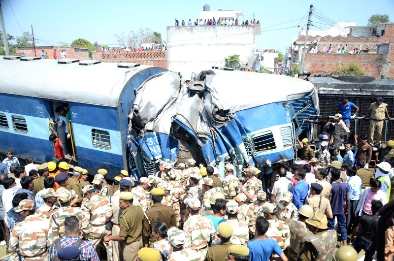 The mangled coaches of the Dehradun-Varanasi Janta Express that derailed in Raebareli of Uttar Pradesh on March 20, 2015. At least 15 people were killed in the accident that involved two ...