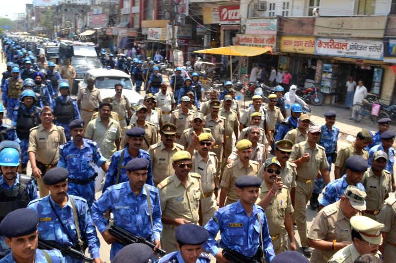 RAF and Police personnel conduct a flag march a day ahead of 9th phase of 2014 Lok Sabha Elections in Varanasi on May 11, 2014.