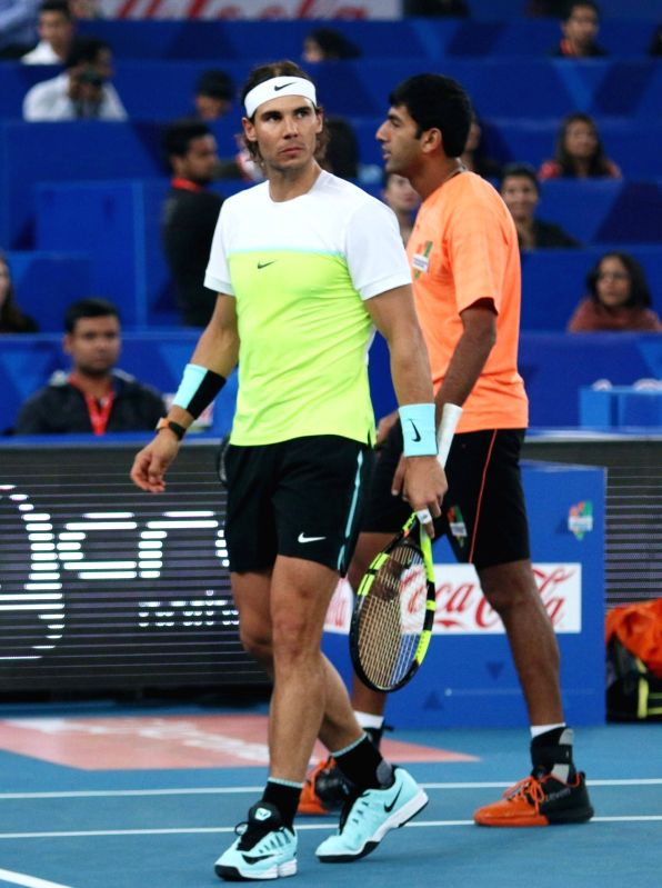 Rafael Nadal and Rohan Bopanna in action against Treat Huey and Edouard Roger-Vasselin during an IPTL match between Micromax Indian Aces and Philippine Mavericks at Indira Gandhi Stadium ... - Rohan Bopanna and Indira Gandhi Stadium