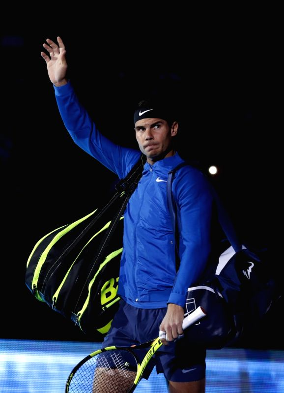 :Rafael Nadal of Spain enters the court for his group stage match against David Goffin of Belgium in the ATP World Tour Finals at O2 Arena in London, Britain on ...