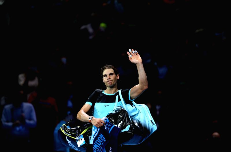Rafael Nadal of Spain greets the spectators after the semifinal against Novak Djokovic of Serbia at the ATP World Tour Finals in London, Britain, Nov. 21, 2015. ...