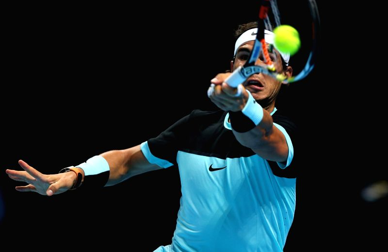 Rafael Nadal of Spain hits a return to Andy Murray of Britain during a men's singles group stage match at the ATP World Tour Finals in London, Britain, Nov. 18, ...