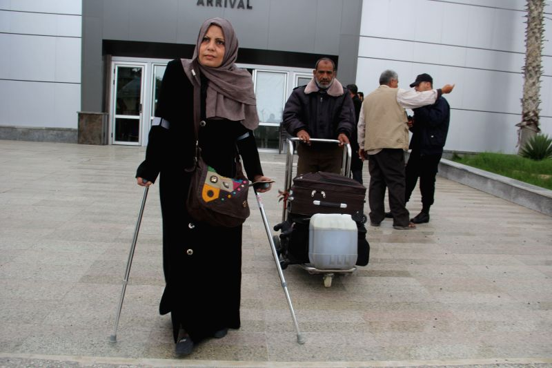 Rafah (Gaza): Palestinians pass into Gaza Strip from Egypt through the reopened Rafah border crossing with Egypt in the southern Gaza Strip city of Rafah, on November 26, 2014. Egypt will reopen ...
