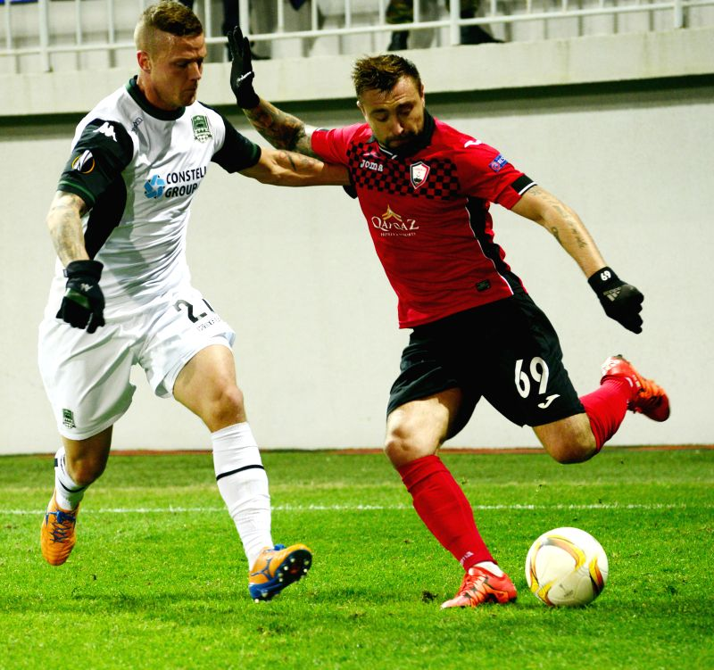 Ragnar Sigurdsson (L) of Krasnodar vies with Olexiy Antonov of Gabala during the UEFA Europa League group C match between Azerbaijan's Gabala and Russia's Krasnodar in ...