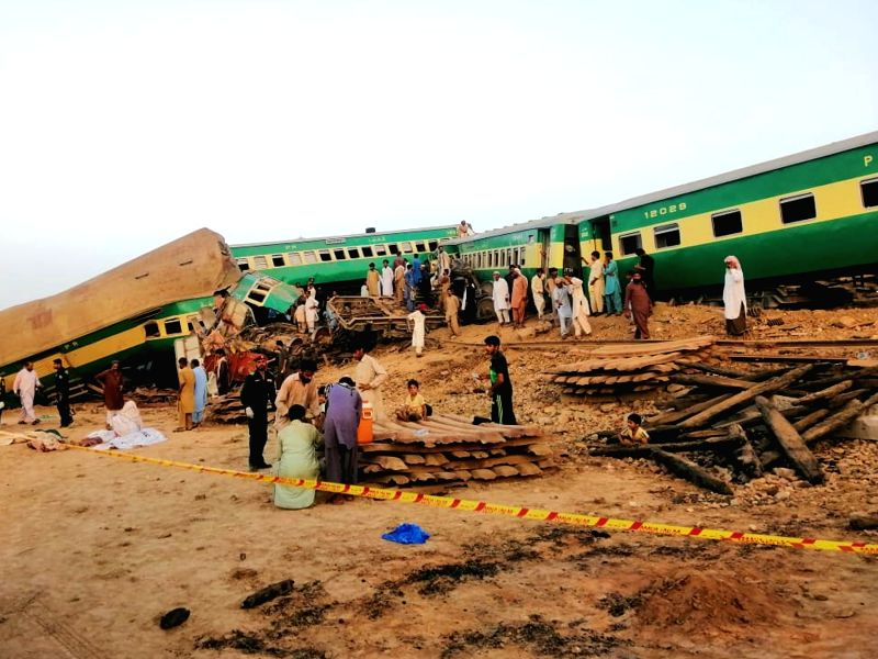 RAHIM YAR KHAN, July 11, 2019 (Xinhua) -- Photo taken with a mobile phone shows people and rescuers working at the train accident site in Pakistan's eastern city of Rahim Yar Khan on July 11, 2019. A passenger train rammed into a freight train in Pak