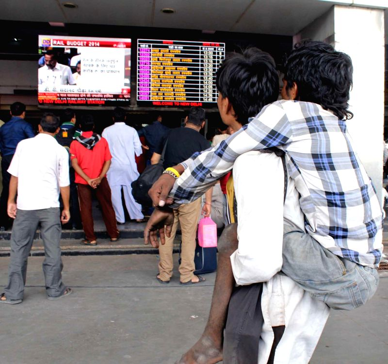 Rail budget 2014-15 being shown on a large screen at New Delhi Railway Station on July 8, 2014.