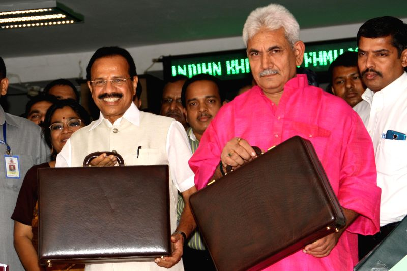 Railway Minister D.V. Sadanand Gowda and MoS for Railways Manoj Sinha at Rail Bhavan before going to present railway budget at Pariament, New Delhi on July 8, 2014. - D. and Manoj Sinha
