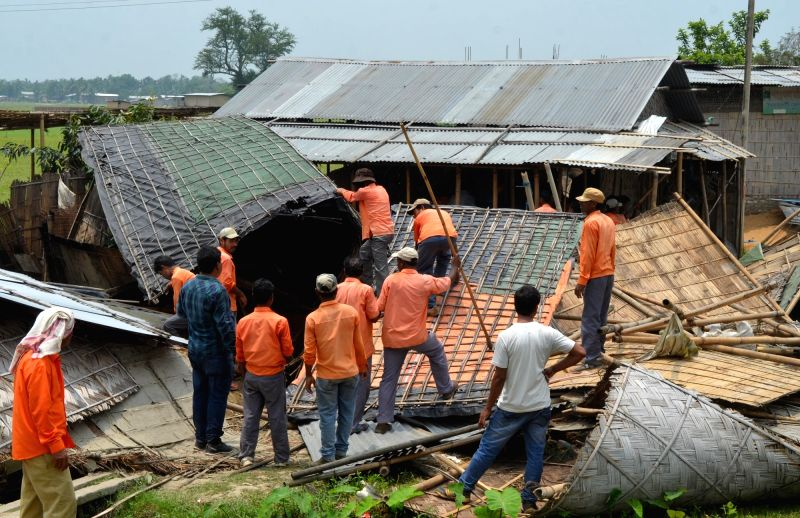 Railway workers carry out eviction drive on railway land in Nagaon district of Assam on May 11, 2016.