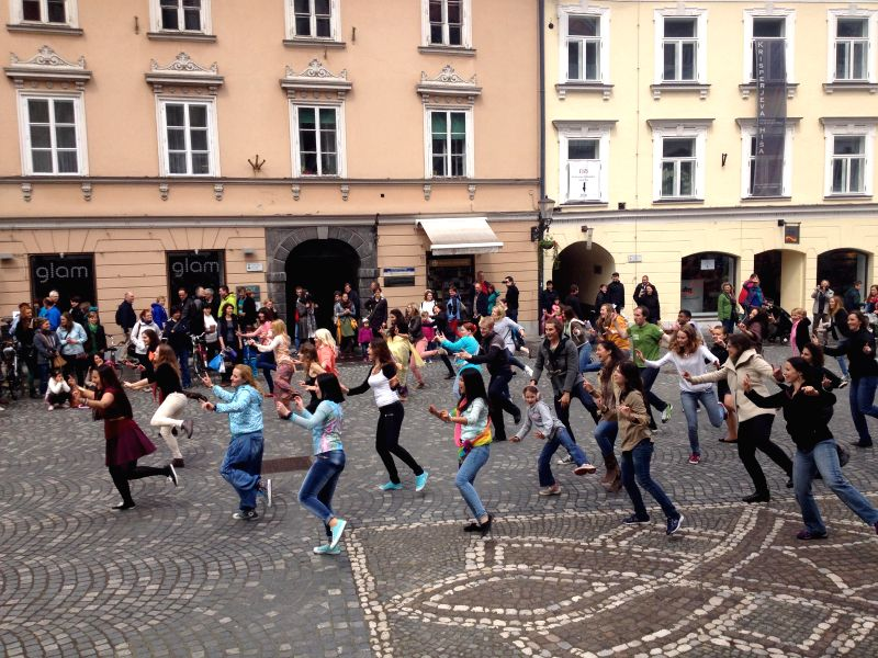 Rains could not prevent the first Bollywood Flashmob in Slovenia from performing. A flashmob is a group of people who gather suddenly in a public place, perform an act for a brief time and then ...