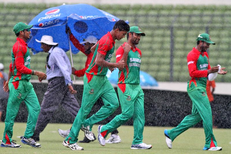 Rains disrupt the third One Day International (ODI) match between India and Bangladesh at the Sher-e-Bangla National Cricket Stadium in Dhaka, Bangladesh on June 19, 2014.